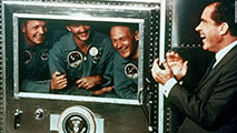 Apollo 11 with Nixon watching on TV