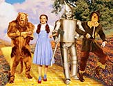 Dorothy and cast walking the yellow brick road