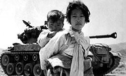 Korean children in front of tank
