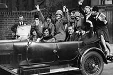 Roaring 20s auto with party revelers in it
